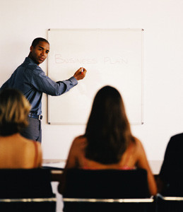 Businessman Conducting a Presentation --- Image by © Royalty-Free/Corbis