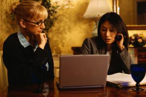 Businesswomen Looking at Laptop